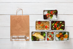 Healthy food delivery, daily meals top view, copy space. Healthy food delivery. Take away of natural organic fitness dishes for diet. Daily ratio nutrition meals Royalty Free Stock Image