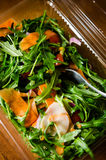 Healthy food delivery. Raw food, salad with rocket and carrots Royalty Free Stock Photo