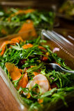 Healthy food delivery. Salad with rocket, turkey ham and carrots Stock Images
