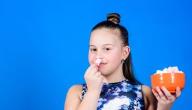 Healthy food and dental care. Small girl eat marshmallow. marshmallow. Candy shop. happy little child love sweets and stock photography