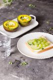 Healthy food for diet as bread fruit and vegetables with egg baked in avocado.  stock photo