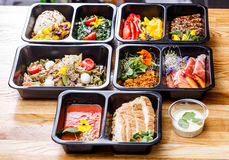 Healthy food and diet concept, restaurant dish delivery. Take away of fitness meal. Weight loss nutrition in foil boxes. Steamed veal with cous and vegetables Royalty Free Stock Photography
