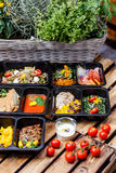 Healthy food and diet concept, restaurant dish delivery. Take away of fitness meal. Weight loss nutrition in foil boxes. Steamed veal with cous and vegetables stock photos