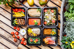 Healthy food and diet concept, restaurant dish delivery. Take away of fitness meal. Weight loss nutrition in foil boxes. Steamed veal with cous and vegetables Royalty Free Stock Images