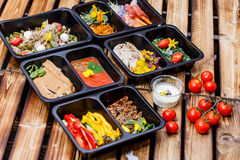 Healthy food and diet concept, restaurant dish delivery. Take away of fitness meal. Weight loss nutrition in foil boxes. Steamed veal with cous and vegetables Stock Photography