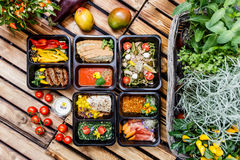 Healthy food and diet concept, restaurant dish delivery. Take away of fitness meal. Weight loss nutrition in foil boxes. Steamed veal with cous and vegetables stock photo