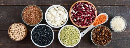 Healthy food, dieting, nutrition concept, vegan protein and carbohydrate source. Assortment of colorful raw legumes: red lentils, green peas, beans, chickpeas stock photography
