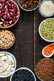 Healthy food, dieting, nutrition concept, vegan protein and carbohydrate source. Assortment of colorful raw legumes: red lentils, green peas, beans, chickpeas royalty free stock images