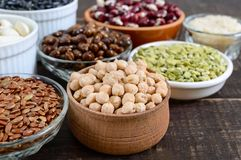 Healthy food, dieting, nutrition concept, vegan protein and carbohydrate source. Assortment of colorful raw legumes: red lentils, green peas, beans, chickpeas royalty free stock image