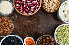 Healthy food, dieting, nutrition concept, vegan protein source. Assortment of colorful raw legumes. Lentils, green peas, beans, chickpeas, rice in bowls stock photos