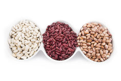 Healthy food. Different kind of organic beanin white dishes isolated on white background Stock Photography