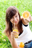 Healthy food and drink. Young woman holding orange and vitamin cocktail Stock Photo