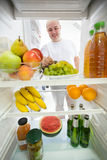 Healthy food and drink in fridge Royalty Free Stock Images