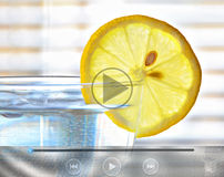 Healthy food and drink video clip. Photo of a zesty slice of lemon on side of glass of water video clip icons for ipad,tablet,computer etc Royalty Free Stock Photography