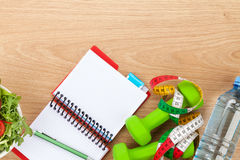 Healthy food, dumbells, tape measure and notepad for copy space Stock Photo