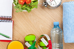 Healthy food, dumbells, tape measure and notepad for copy space Royalty Free Stock Photos