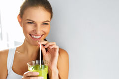 Healthy Food Eating. Woman Drinking Smoothie. Diet. Lifestyle. N. Healthy Food Eating. Happy Beautiful Smiling Woman Drinking Green Detox Vegetable Smoothie