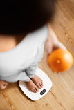 Healthy Food Eating. Woman On Weighing Scale. Weight Loss. Diet. Royalty Free Stock Images