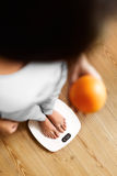 Healthy Food Eating. Woman On Weighing Scale. Weight Loss. Diet. Stock Photos