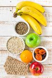 Healthy Food Fiber Source Breakfast Oatmeal Fruits Apples Green Red Bananas Orange Milk Thistle, Rye Bran Scandinavian Crispbread. White Plank Wood Table. Flat Stock Photography