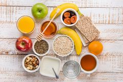 Healthy Food Fiber Source Breakfast Oatmeal Honey Fruits Apples Banana Orange Juice Water Green Tea Nuts. White Plank Wood Table Royalty Free Stock Image