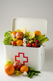Healthy food. First aid box filled with fruits and vegetables. Healty food. First aid box filled with fresh fruits and vegetables on white background Stock Image