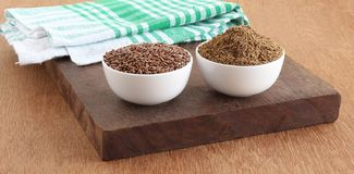 Healthy Food Flaxseeds and Flaxseeds Powder in Bowls on Wooden Board Stock Photography
