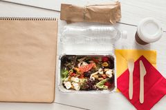 Healthy food in foil boxes, diet concept. Seafood salad Royalty Free Stock Photos