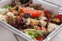 Healthy food in foil boxes, diet concept. Seafood salad mix Royalty Free Stock Photos