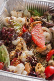 Healthy food in foil boxes, diet concept. Seafood salad mix Stock Photos