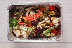 Healthy food in foil boxes, diet concept. Seafood salad mix Stock Photography