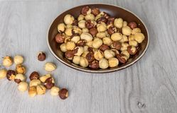 Free Healthy Food For Background Image Close Up Hazelnuts. Nuts Texture On Top View On The Cup Plate Royalty Free Stock Photos - 142153018
