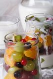 Healthy food: fresh fruit in a glass jar and yoghurt macro Royalty Free Stock Images