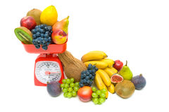 Healthy food - Fresh fruit and kitchen scale on white background Royalty Free Stock Images