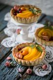 Healthy food is fresh fruits and berries, peaches, apples, cranberries, Cape gooseberries in a basket from dough Royalty Free Stock Images
