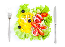 Healthy food fresh vegetable salad top view. Healthy food fresh vegetable salad knife and fork Stock Photos
