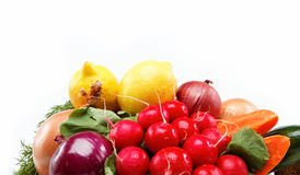 Healthy food. Fresh vegetables and fruits. Healthy food. Fresh vegetables and fruits on a wooden board Stock Image