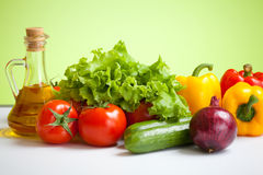 Healthy food fresh vegetables still life with oil Stock Photos