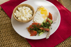 Healthy food: fried eggs and cottage cheese Royalty Free Stock Images