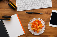 Healthy food - fruit snack at workplace Stock Photos