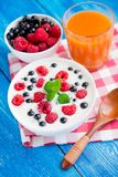 Healthy food with fruit and yoghurt. Sweet breakfast with healthy food with fruit and yoghurt on blue wood table stock image