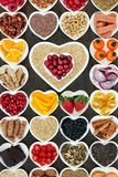 Healthy Food for Good Health. Healthy food for good heart health with superfood of fish, fruit, vegetables, pulses, nuts, seeds, grains, cereals with herbs and stock photo