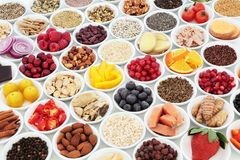 Healthy Food for Good Heart Health. Health food for a healthy heart concept with superfood of fish, fruit, vegetables, pulses, nuts, seeds, grains, cereals with royalty free stock photos