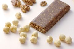 Healthy food granola bar with nuts on white background stock image