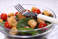 Healthy food green salad in glass bowl with fork Royalty Free Stock Images