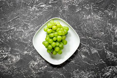 Healthy food with green vegetables, fruits for dinner on dark table background top view Royalty Free Stock Images
