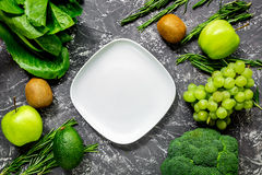 Healthy food with green vegetables, fruits for dinner on dark table background top view mock-up. Healthy food with green vegetables, fruits for fitness dinner on Stock Image