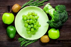 Healthy food with green vegetables, fruits for dinner on rustic. Healthy food with green vegetables, fruits for fitness dinner on rustic table background top Royalty Free Stock Photography