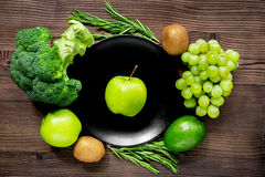 Healthy food with green vegetables, fruits for dinner on rustic table background top view. Healthy food with green vegetables, fruits for fitness dinner on Royalty Free Stock Photography