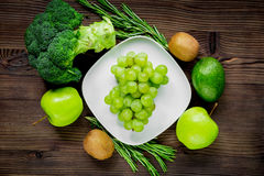 Healthy food with green vegetables, fruits for dinner on rustic table background top view. Healthy food with green vegetables, fruits for fitness dinner on Royalty Free Stock Images